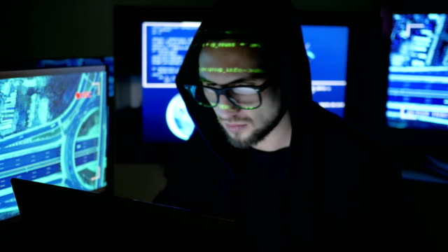 Computer-hacker-stealing-money-With-stolen-bank-card-steal-finance-through-Internet-hackers-trying-to-gain-access-to-a-computer-system-hacks-computer