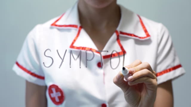 SYMPTOMS-Female-doctor-writing-on-transparent-screen