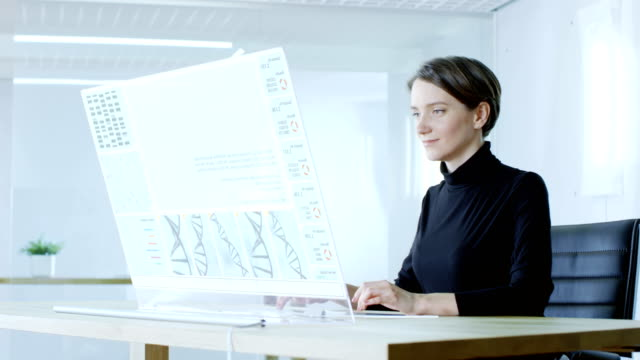 in-the-Near-Future-Female-Scientist-Works-on-Sequencing-Human-Genome-Screen-Shows-Strings-of-DNA-and-Running-Code-Line-