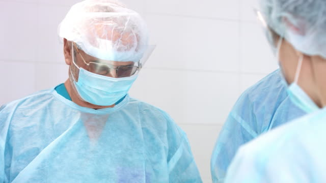 The-concentrated-surgeon-performs-the-operation