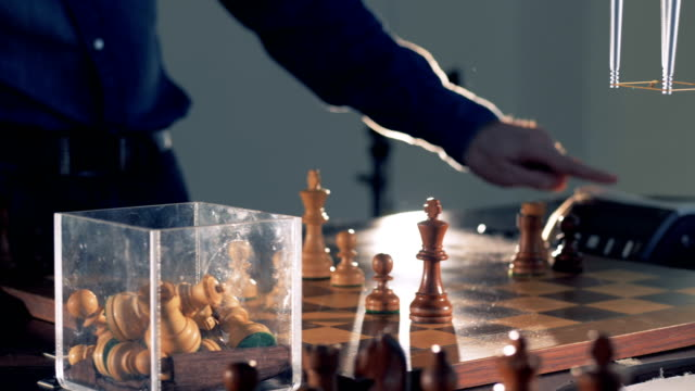 Game-close-up-view-between-chess-player-and-robot-