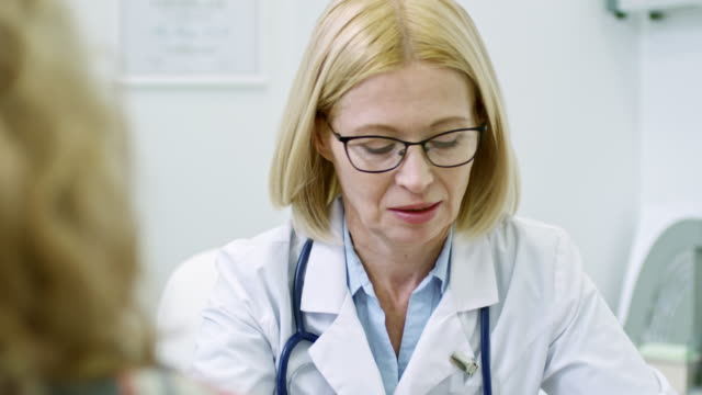 Mature-Doctor-Talking-to-Patient
