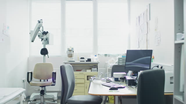 Bright-and-Modern-Medical-Doctor-s-Office-Complete-with-Personal-Computer-and-ENT-Ophthalmology-Equipment-