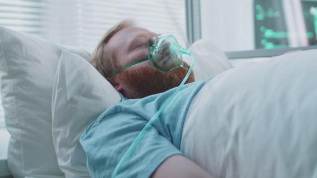 Coronavirus-Patient-on-Ventilator-with-IV-Drip-in-Hospital-Ward