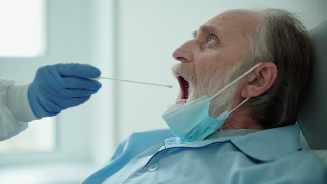 Nurse-taking-swab-sample-from-patient-s-throat-detection-of-covid-19-pcr-test