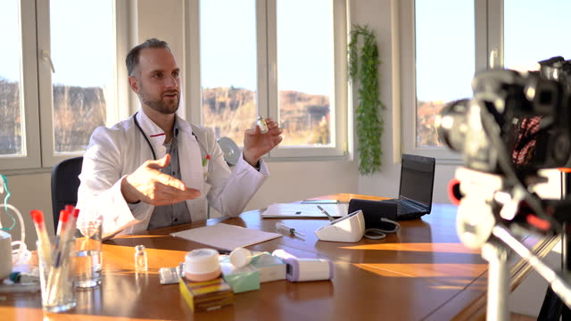 Doctor-giving-online-consultation-to-patient-by-video-call-from-his-office-about-COVID-19-prevention