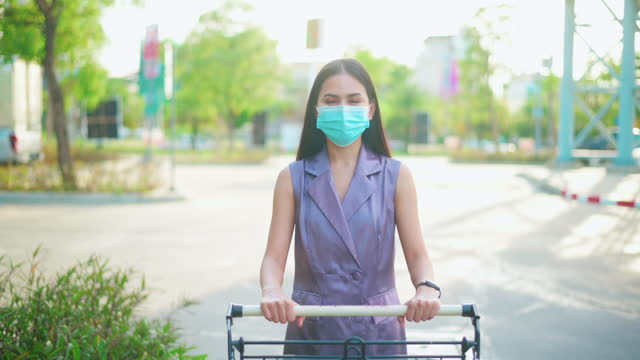 a-young-woman-is-wearing-face-mask-in-shopping-center