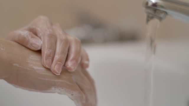 Little-Girl-Washing-Hands-With-Soap-Over-Sink-in-Bathroom-Woman-Washing-Hands-Rubbing-With-Soap-Child-For-Corona-Virus-Prevention-Hygiene-to-Stop-Spreading-Coronavirus-Slow-Motion-