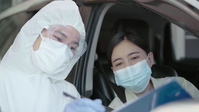 Doctor-officer-test-coronavirus-or-Covid-19-at-the-people-drive-Thru