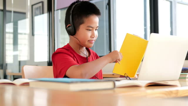 asian-boy-student-studying-learning-lesson-online-remote-meeting-distance-education-at-home