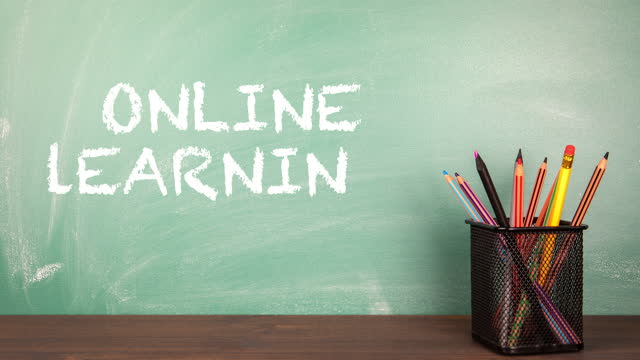 ONLINE-LEARNING-School-classroom-with-green-chalk-board