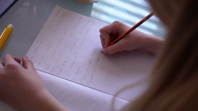 Girl-writing-homework-at-home