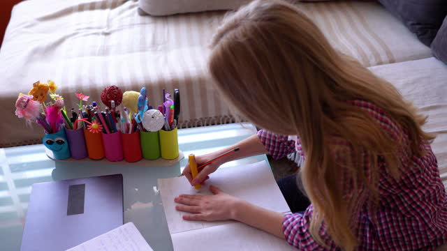Girl-writing-her-homework-assignment-at-home