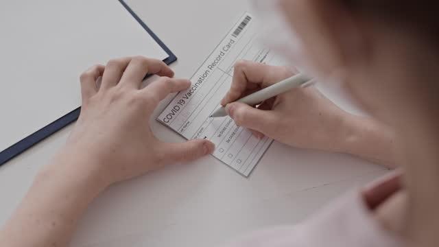 Filling-in-Covid-19-Vaccination-Record-Card