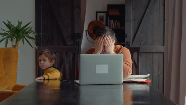 father-trying-to-teach-child-homeschooling-lessons-at-home