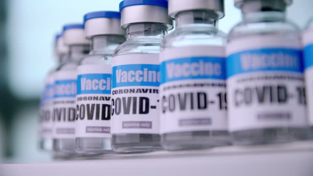 Glass-vials-for-Covid-19-vaccine-in-laboratory-Group-of-Coronavirus-vaccine-bottles-Medicine-in-ampoules-