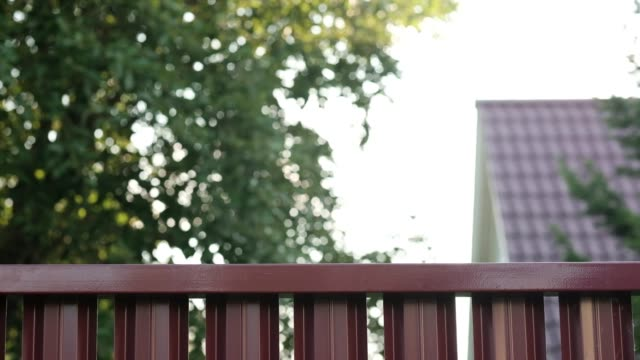 Senior-man-looking-through-fence-spying-on-his-neighbor-