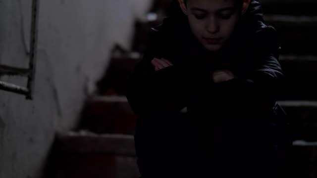 hooligan-boy-sits-alone-in-an-old-ramshackle-building-demolition-house