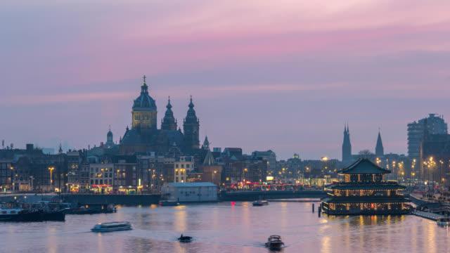 Amsterdam-Netherlands-time-lapse-4K-city-skyline-day-to-night-timelapse-at-Basilica-of-Saint-Nicholas