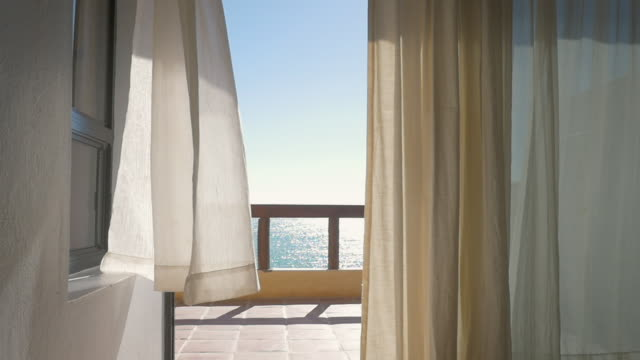 White-Curtains-at-an-Oceanfront-Resort-Blowing-in-a-Summer-Breeze---Slow-Motion