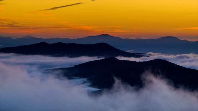 Fast-moving-Misty-Clouds-at-Golden-Sunrise-over-Blue-Ridge-Mountains