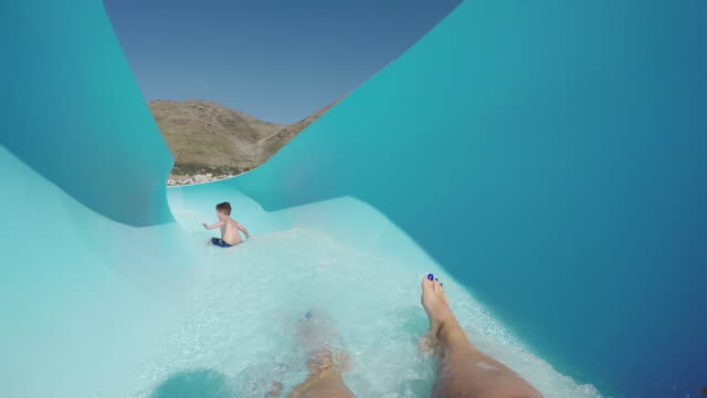 Point-of-view-of-happy-young-boy-going-down-waterslide-Cape-Town-south-Africa