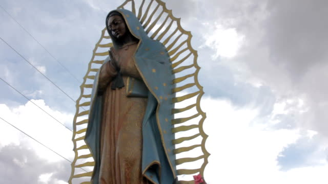 Low-Angle-Shot-of-a-Statue-of-the-Virgin-of-Guadalupe