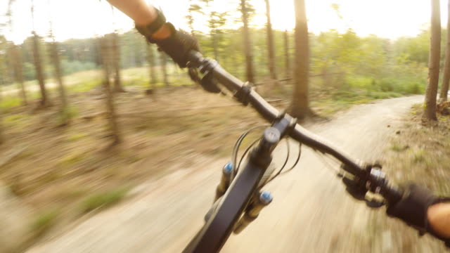 Man-riding-on-mountain-bike-cycling-personal-perspective-view