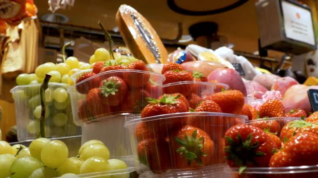 Counter-with-Fruits-at-a-Market-in-La-Boqueria-Barcelona-Spain