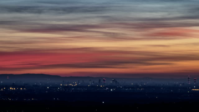 Timelapse-of-the-modern-city-of-Milan-Italy-at-sunset-from-day-to-night-Aerial-View