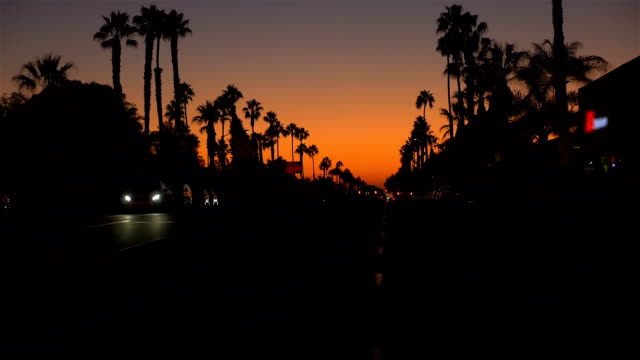 POV-driving-a-car-at-sunset-in-California-slow-motion