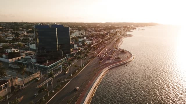 Beautiful-sunset-over-the-sea-and-city-Campeche-Malecon-and-Sea-aerial-view-Treadmill-and-bicycle-path-on-the-waterfront