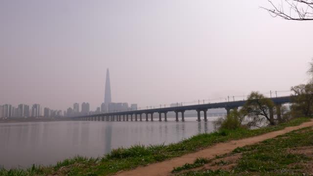 Panorama-on-Seoul-Lotte-World-Tower-Hun-River-and-Jamsil-Railway-Bridge