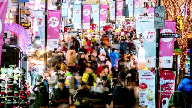 Timelapse-of-Myeongdong-shopping-area-Busy-and-crowded-people-hawker-and-shoppers-Tight-shot-