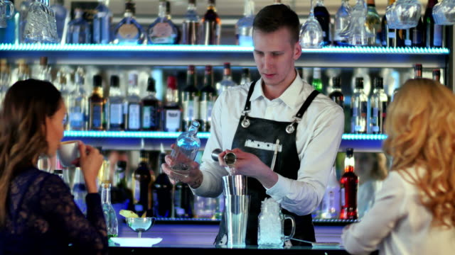 Barman-makes-cocktails-with-a-shaker