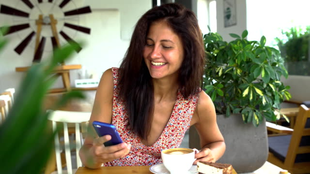 Young-woman-use-smartphone-and-smile-Chatting-with-boyfriend