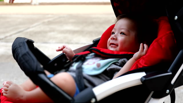 boy-child-laughing-happy-in-baby-stroller-carriage-seat
