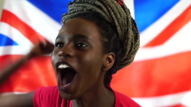 UK-Young-Black-Woman-Celebrating-with-UK-Flag