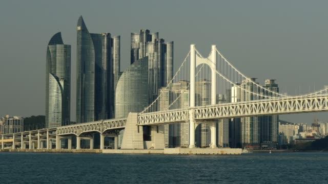 Busan-South-Korea-Pannnig-shot-of-GwangAn-Bridge-and-skyscrapers-in-city-center-of-Busan-4K-UHD