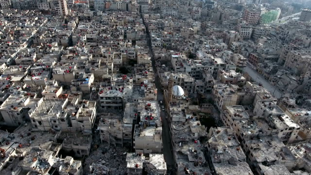 Aerial-view-of-ruined-homs-in-Syria-birds-flying-in-the-sky