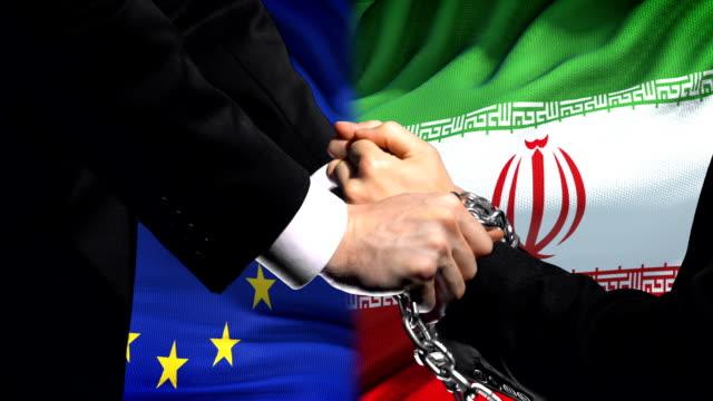 European-Union-sanctions-Iran-chained-arms-political-or-economic-conflict