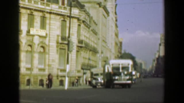 1952:-Classic-municipal-bus-transportation-shuttles-downtown-city-streets-