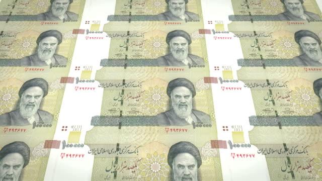 Banknoten-der-hunderttausend-iranische-Rial-des-Iran-Bargeld-Schleife