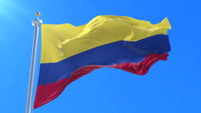 Colombia-flag-waving-at-wind-in-slow-with-blue-sky-loop