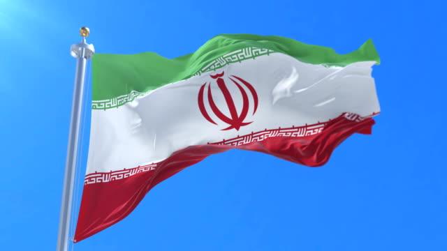 Flag-of-Iran-waving-at-wind-in-slow-in-blue-sky-loop