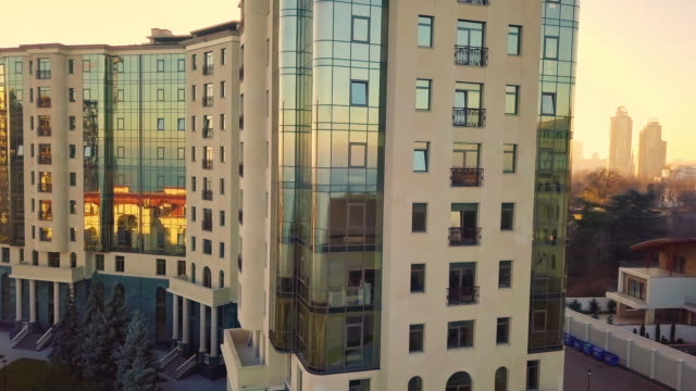 Aerial-Drone-Flight-Footage:-Picturesque-view-on-cityscape-with-glass-business-center-in-sunset-light