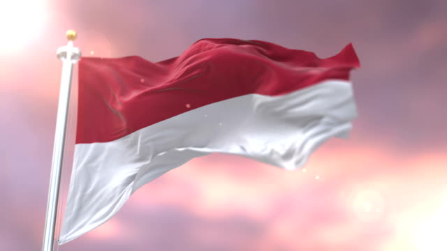 Flag-of-Indonesia-waving-at-wind-in-slow-at-sunset-loop