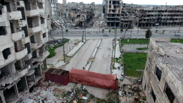 Aerial-view-over-a-road-in-Syria-cars-in-background