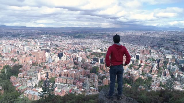 Man-looking-at-Bogota-from-the-mountain