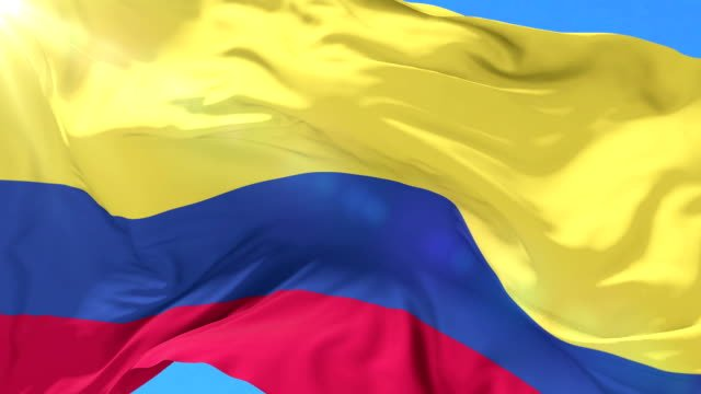 Colombian-flag-waving-at-wind-in-slow-with-blue-sky-loop